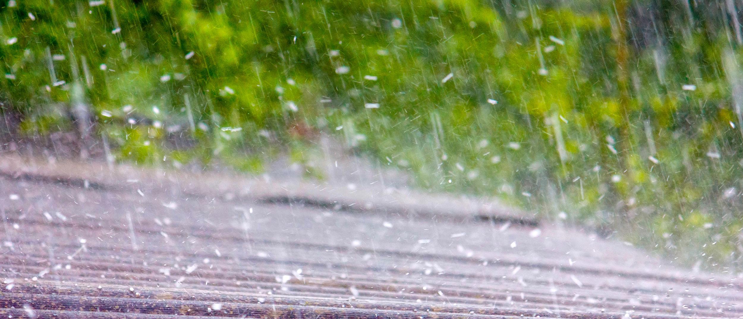 Hail hitting a roof in San Antonio hail storm