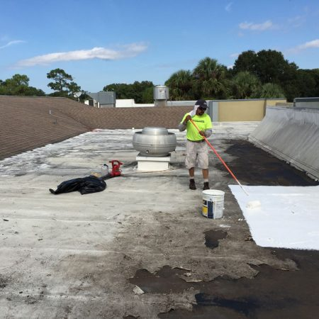 Man repairing a commercial TPO roof in San Antonio